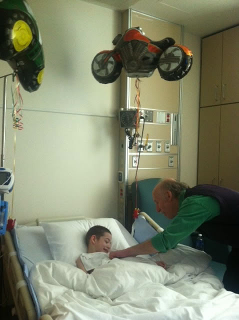 Jackson visiting a boy at  his hospital bed