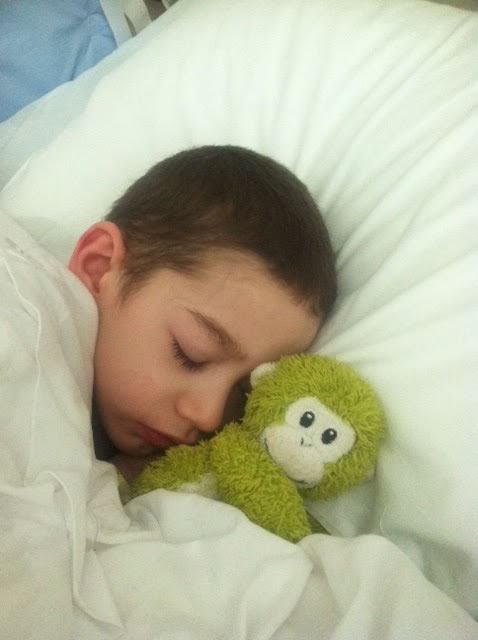 Aidan asleep with his stuffed monnkey